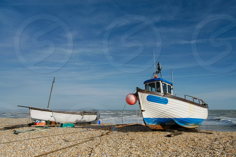 Fishing boats on Dungeness beach photo
