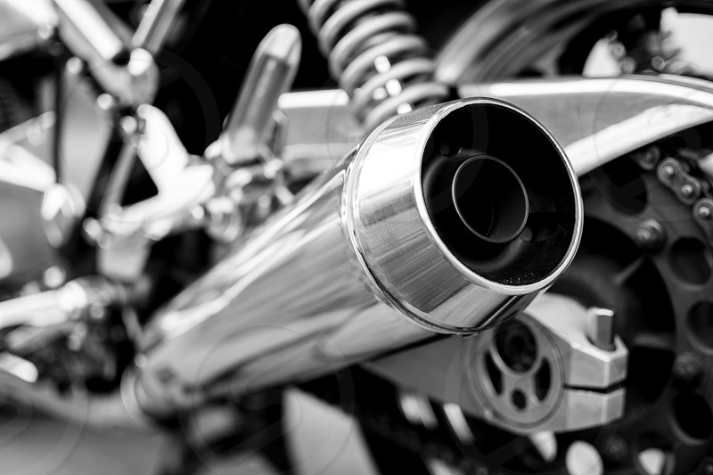 Chromed exhaust on a vintage motorcycle photo