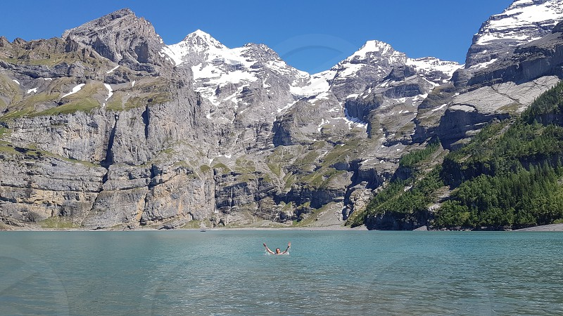 Swimming in a mountain lake  Oeschinensee Switzerland photo