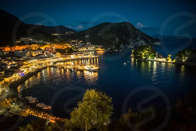 The Harbor Of Beautiful Parga Village By Night In GreeceEpirus Region photo