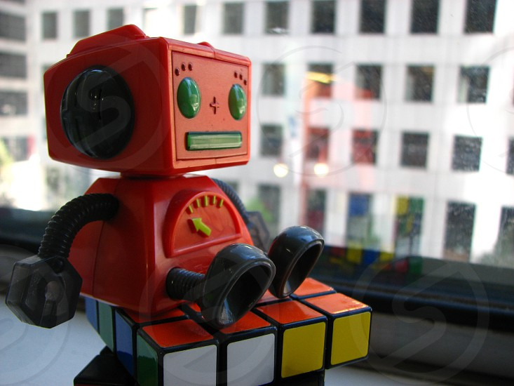 red and black robot toy photo