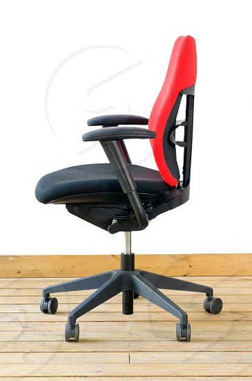 modern red office chair on wood floor over white background photo
