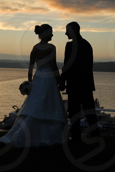 Silhouette Wedding lovers at sunset photo