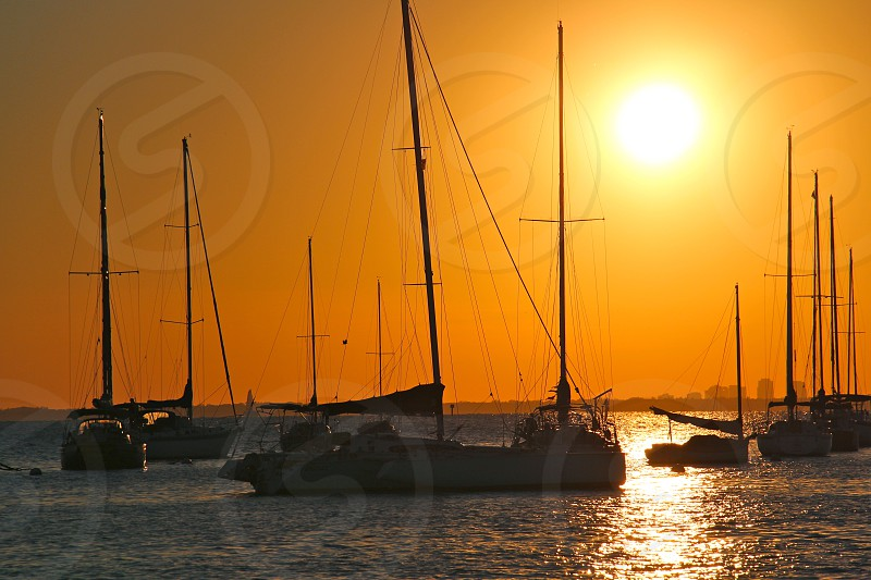 motorboats on sea during sunset photo