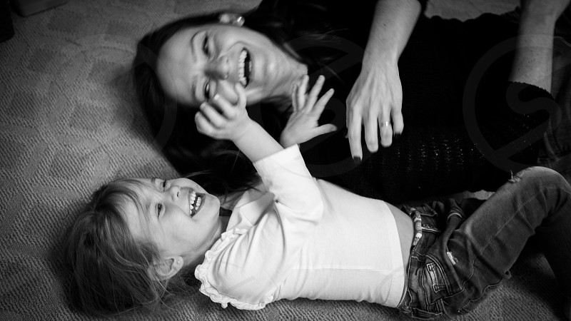 Laughters play time mom and daughter  photo