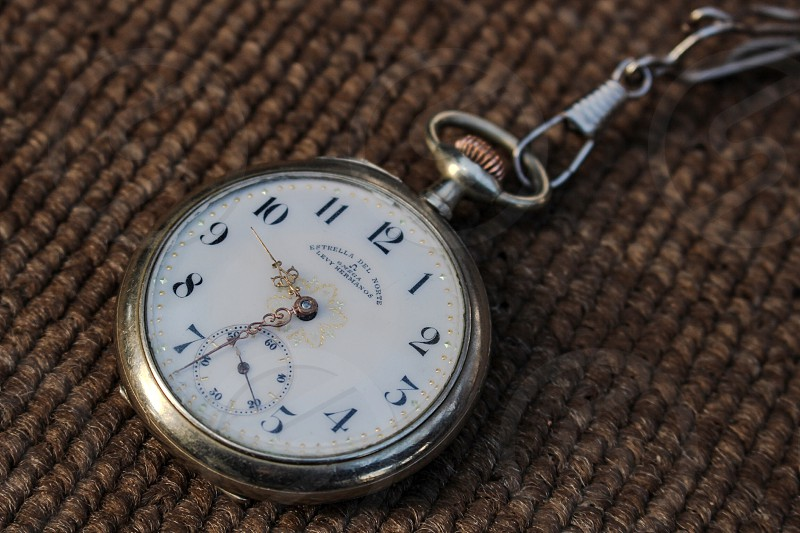 100 year old antique pocket watch. photo