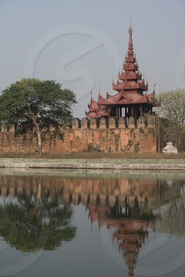 the Moat and Fortress wall of the Royal Palace in the City of Mandalay in Myanmar in Southeastasia. photo