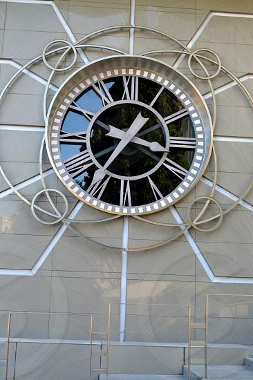 Beautiful clock on a stone wall. photo