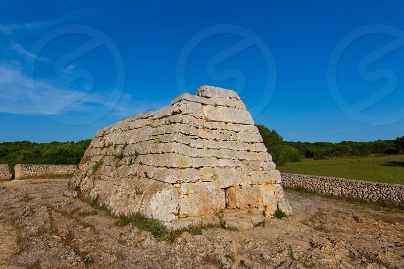 Menorca Ciutadella Naveta des Tudons megalithic chamber tomb In Balearic islands photo