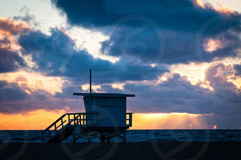 Lifeguard tower at sunset photo