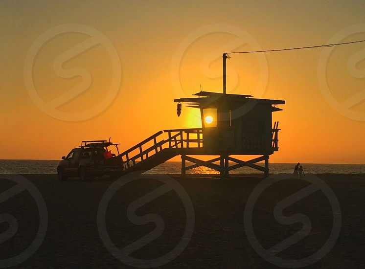 Venice beach sunset mood sun guard tower safety patrol patrol vehicle photo