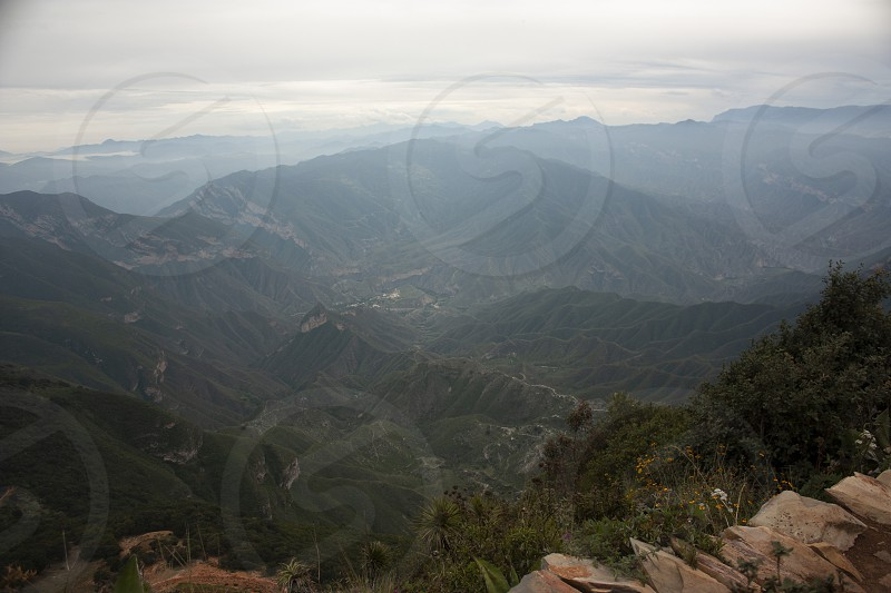 Idyllic landscape of the mountainous rocks of closes Gorda in Mexico among fog photo