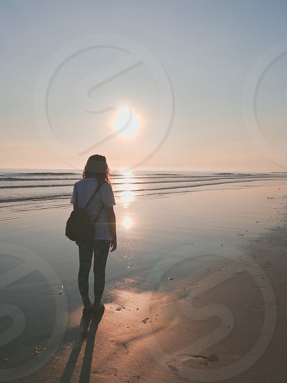 view of a woman in the seashore photo