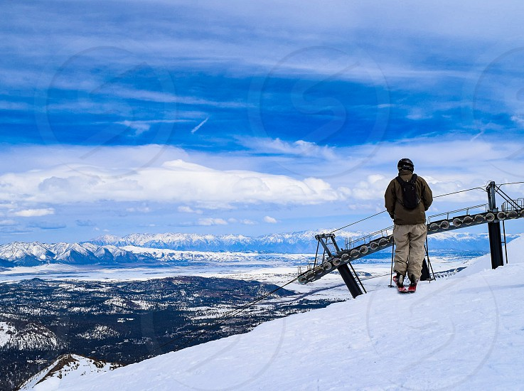 This skier pauses at the top of the gondola before proceeding over the cornice at Mammoth photo