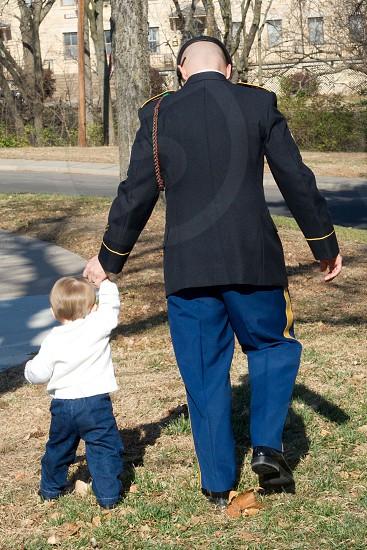 man and child walking photo