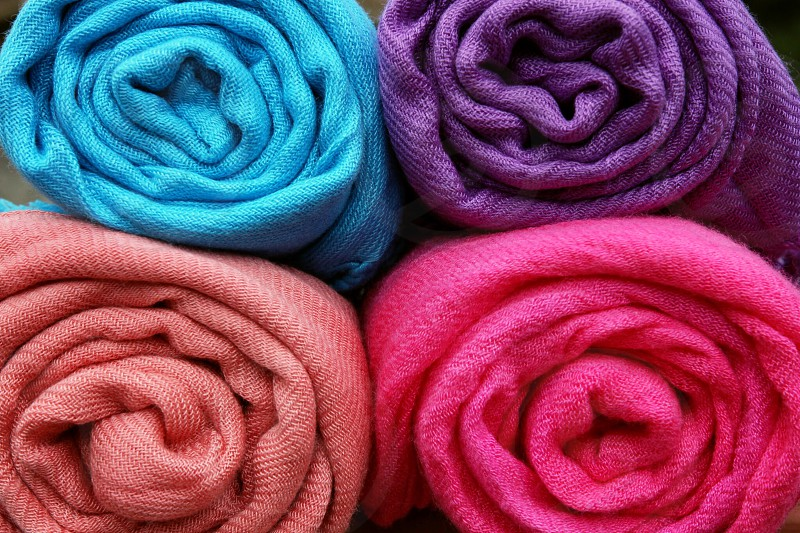Rolled scarfs fabric cotton textiles colorful closeup  photo