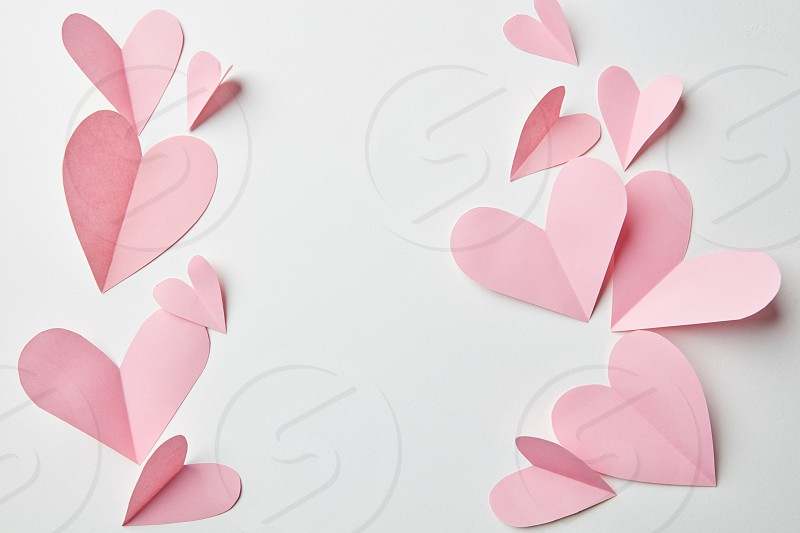 frame with paper hearts on a white background photo