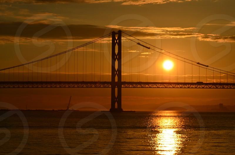 view bridge with sunset background photo
