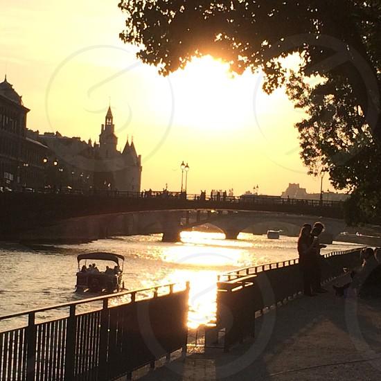 The river seine Paris sunset boat spring bridge sun romantic photo