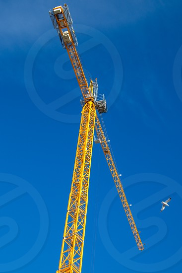 WORTHING WEST SUSSEX/UK - NOVEMBER 13 : View of a yellow crane  in Worthing West Sussex on November 13 2018 photo