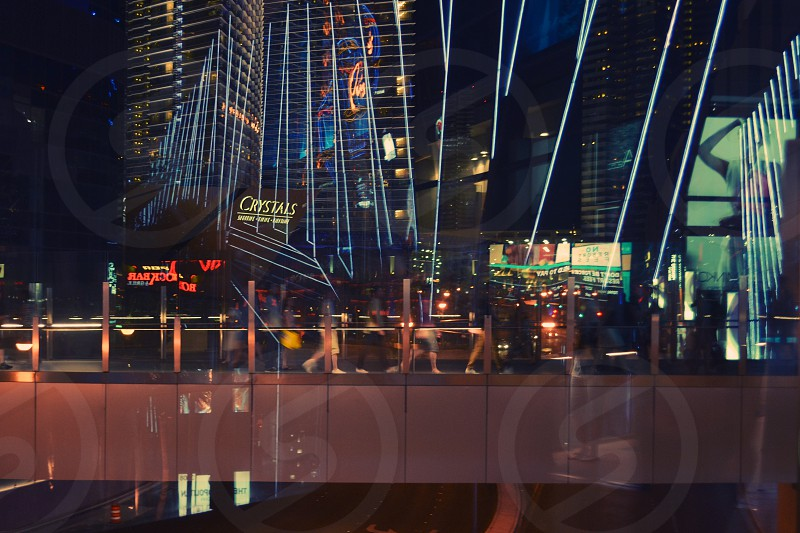 Walking bridge neon reflections Las Vegas photo