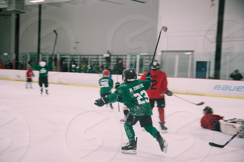 person playing hockey photo