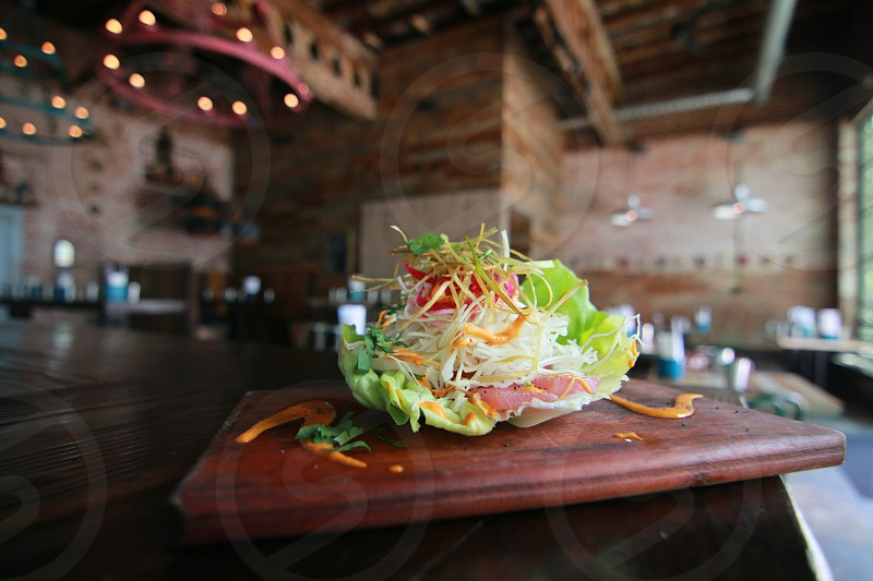 "Dos Santos in Denver Colorado. Pictured here the Raw tuna and pickled onion on a lettuce ""tortilla"". photo"