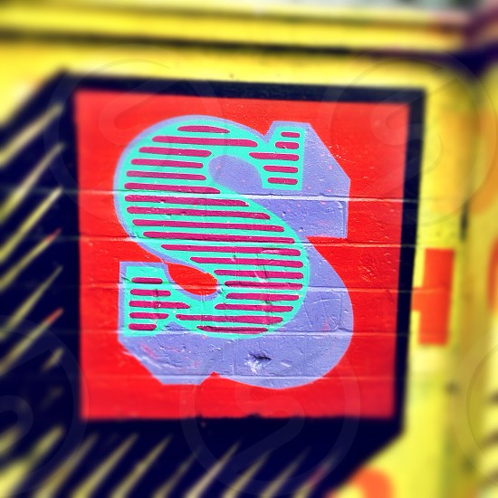 Letter S. Detail of street art by artist Ben Eine in Shoreditch London England.  photo