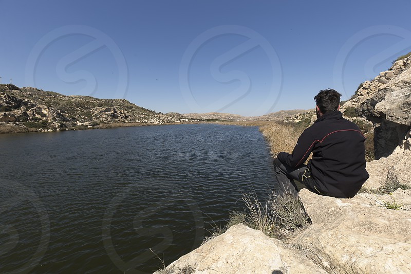 Man observing the swamp of Elche in the province of Alicante. photo