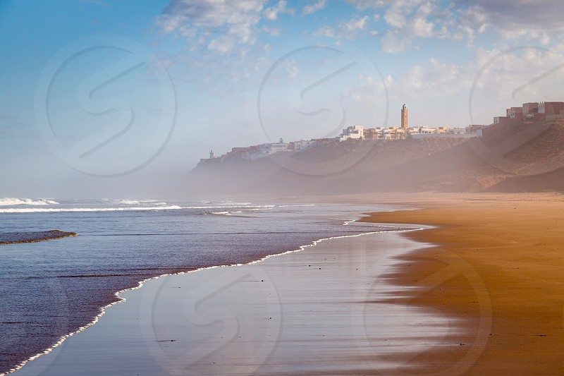 Early in the morning after rain on the coast of Sidi Ifni southwestern Morocco Atlantic ocean photo