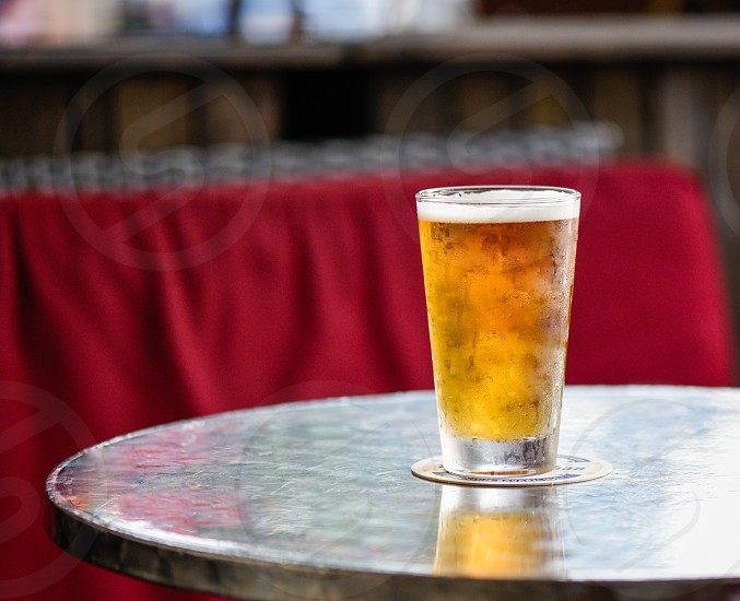 clear drinking glass with beer photo