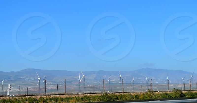 Wind generators along the road. wind energy. wind power. Wind power station  photo