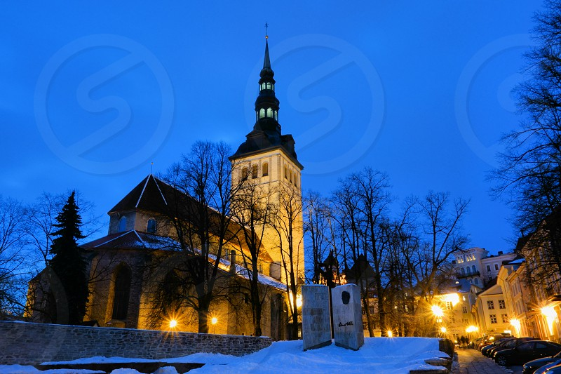St. Nicholas' Church in Tallinn Estonia on winter early evening light. photo