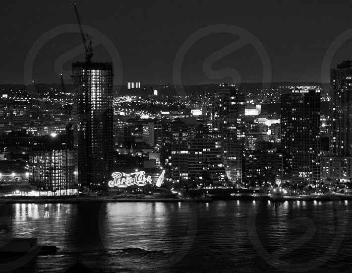 queens pepsi sign waterfront night tower residential   photo
