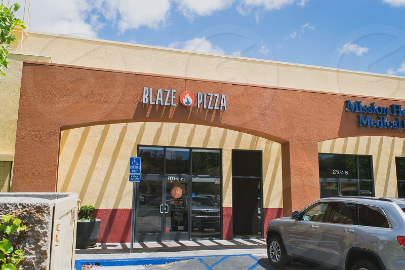 silver suv parked outside blaze pizza building during daytime photo