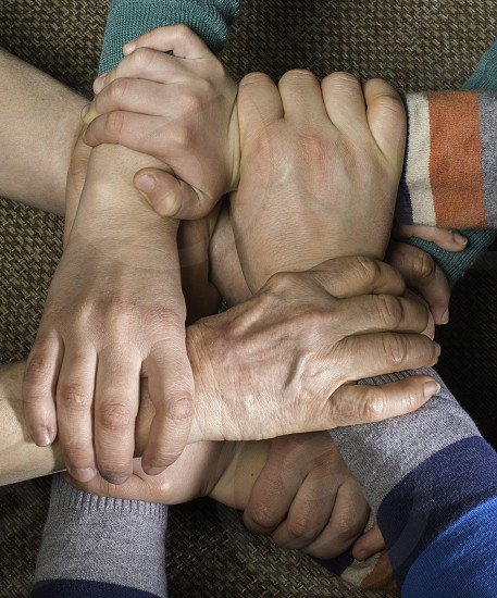Many hands together. Interior shot photo
