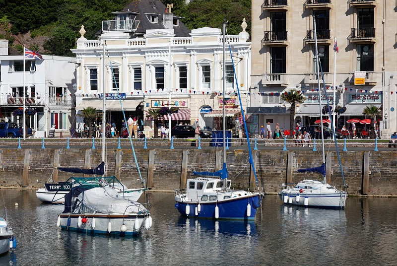 TORQUAY DEVON/UK - JULY 28 : View of the Town and Harbour in Torquay Devon on July 28 2012. Unidentified people photo