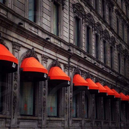 Orange awnings on city hotel in Montreal.  photo