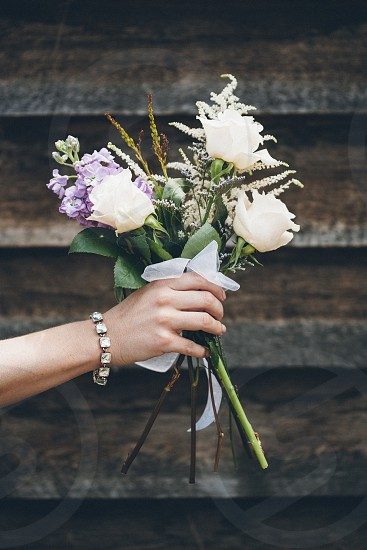 hand holding a bouquet of flowers  photo