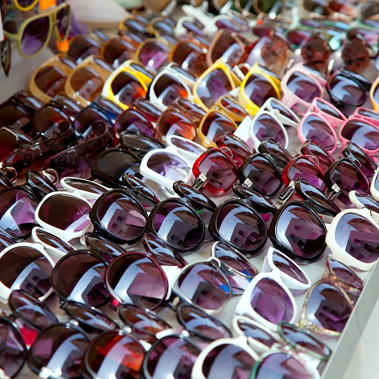 Fashion sunglasses rows in outdoor shop display pattern photo