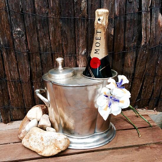 black labeled bottle in stainless steel bucket near beige stone photo
