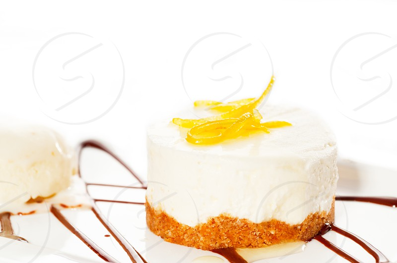 very elegant lemon mousse dessert served whith lemon peel on top and vanilla ice cream on side MORE DELICIOUS FOOD ON PORTFOLIO photo