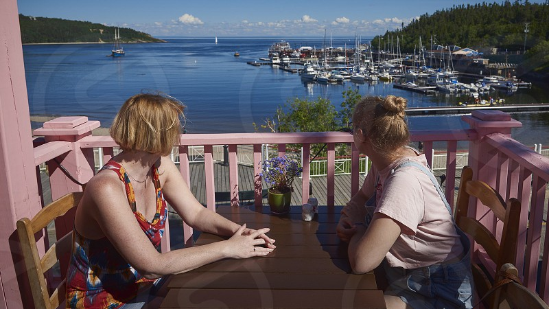 Mom ans daughter looking to the ans of Tadoussac in Quebec during summer photo