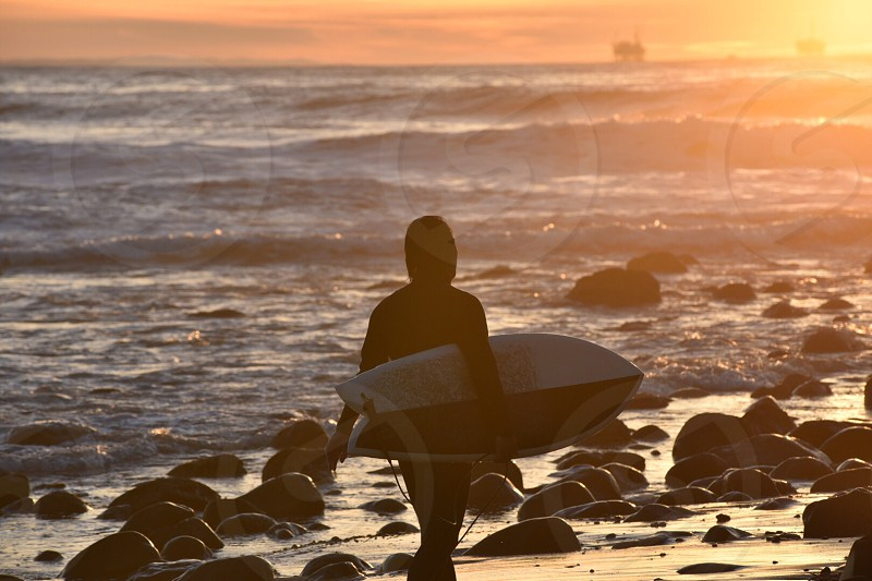 person holding white surfing board photo