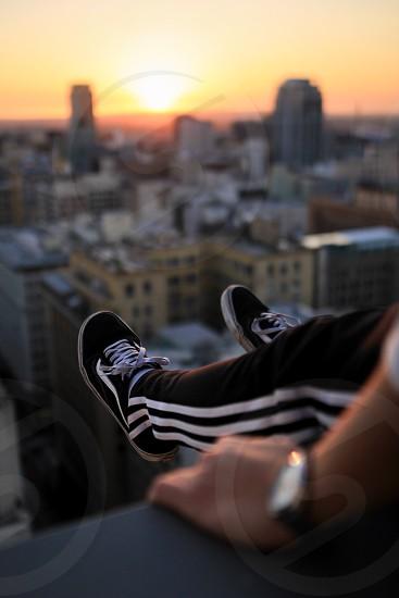 Feet shoes vans skate adiddas rooftop city rooftop roof street urban sunset colors ledge Los Angeles la downtown dtla  photo