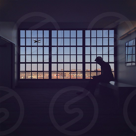 man sitting silhouette photo