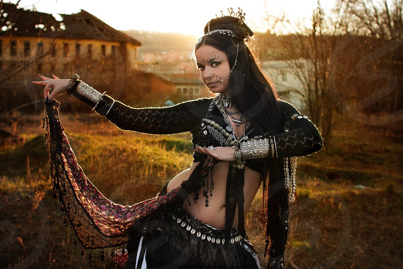 Beauty Tribal Belly Dance Woman in the sunset photo