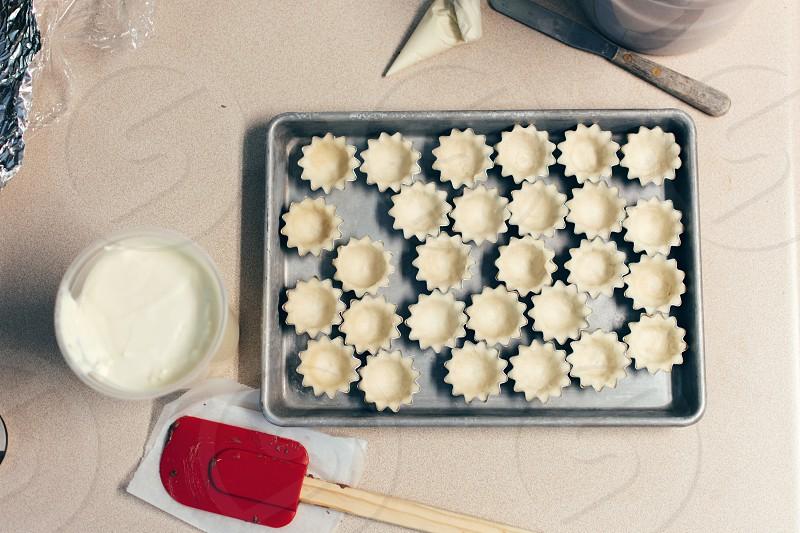 several tarts on black baking tray photo