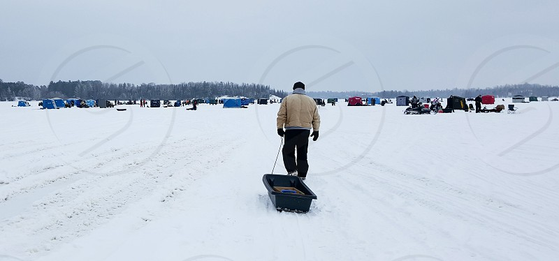 Ice fishing winter family gear fishing snow lake photo