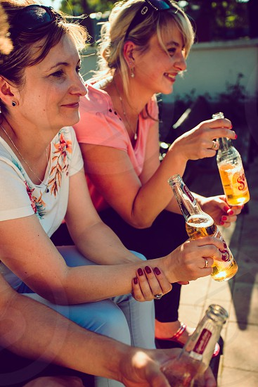 Leczna / Poland - May 27 2018: Friends spending time together outdoors in the center of town having fun and enjoying the Sol beer photo